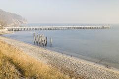 Baltic sea and pier in gdynia orlowo in poland in the winter, europe Stock Photos