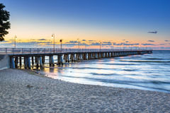 Baltic sea with pier in Gdynia Orlowo at sunrise Stock Photos