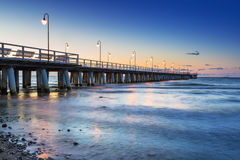 Baltic sea with pier in Gdynia Orlowo at sunrise Stock Image