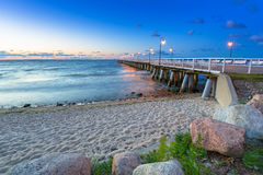Baltic sea with pier in Gdynia Orlowo at sunrise Royalty Free Stock Photo