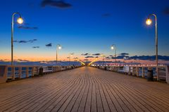 Baltic sea pier in Sopot at sunrise. Poland royalty free stock image