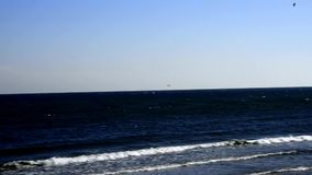Baltic Sea in Poland, beach of Ustka. With wavebreaker of the port mole stock video footage