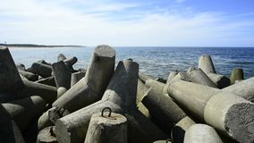 Baltic Sea in Poland, Ustka with wavebreakers. And view to the coastline stock video footage