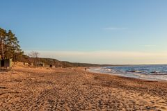 Baltic sea sandy beach background. Calm Baltic sea seashore beach background in golden hour sand dune grass latvia sunset path landscape sky coast travel nature royalty free stock photography