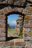 The Baltic Sea seen through window at Hammershus Castle. The baltic Sea seen through a window in the ruins of the medieval castle of Hammershus at Bornholm Royalty Free Stock Images