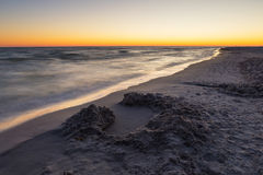 Baltic sea shore after sunset Stock Images