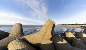 Baltic sea side beach pier. Baltic sea side beach pier in bright sunny day with cold winter winds. Some beautiful scenes of sea side stones royalty free stock photos