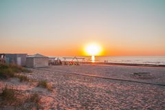 Baltic sea in sunset warm light. Sandy beach in Jurmala, Latvia, East Europe. Baltic sea in spring sunset warm light. Sandy beach in Jurmala, Latvia, East royalty free stock photography