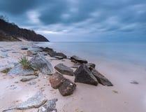 Baltic sea stone breakwater Stock Photos