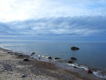 Baltic sea, stones  and beautiful cloudy sky, Lithuania Royalty Free Stock Images