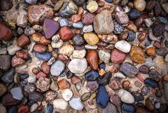 Baltic sea stones and pebbles background. Picture with vignetting effect Royalty Free Stock Photo