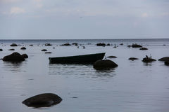 Baltic Sea with stones, sea gulls and a fishing boat Royalty Free Stock Photography