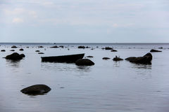 Baltic Sea with stones, sea gulls and a fishing boat Stock Photo