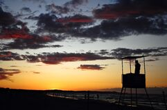 Baltic sea sunrise lifeguard silhouette Royalty Free Stock Images
