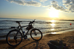 Baltic Sea at sunset and bike Stock Photos