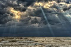 The Baltic Sea at sunset, stormy clouds Royalty Free Stock Images