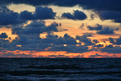 The Baltic Sea at sunset. View of the Baltic sea and cloudy sky at sunset Royalty Free Stock Photo