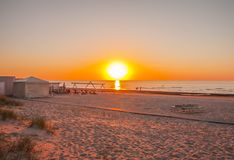 Baltic sea in sunset warm light. Sandy beach in Jurmala, Latvia, East Europe. Baltic sea in spring sunset warm light. Sandy beach in Jurmala, Latvia, East stock images