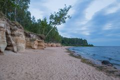 Baltic sea with waves, rocks and blue sky. Summer evening. stock photography