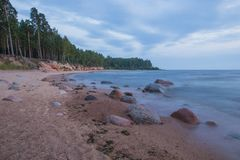 Baltic sea with waves, rocks and blue sky. Summer evening. royalty free stock images