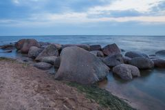 Baltic sea with waves, rocks and blue sky. Summer evening. stock photos
