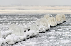 Baltic sea in winter. Scenic view of frozen pier in Baltic sea, winter scene Stock Photo