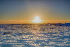 Ice hummocks plays colors of rainbow in direct sunlight. Baltic sea in winter. Fresh ice hummocks and cracks in ice edge Royalty Free Stock Image