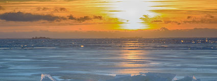Ice hummocks plays colors of rainbow in direct sunlight. Baltic sea in winter. Fresh ice hummocks and cracks in ice edge Stock Photography