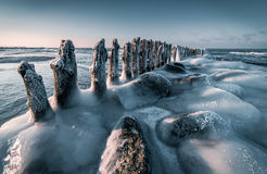 Baltic Sea in winter. Iced over breakwater on the Baltic Sea in winter Stock Photo