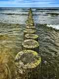 Baltic Sea. Wooden breakwater on a Baltic Sea in Poland Royalty Free Stock Photography