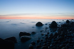 Baltic seaside with stones after sunset. Baltic seaside after sunset in Klaipeda, Lithuania Royalty Free Stock Photography