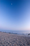Baltic seaside after sunset with moon. Baltic seaside after sunset in Klaipeda, Lithuania Royalty Free Stock Photo