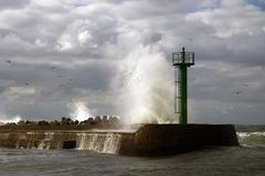 Baltic storm. Storm wave crashing against  letty with beacon. Baltic, Poland Stock Photography