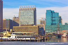 Baltimore downtown and docked ships at the Inner Harbor pier Stock Images