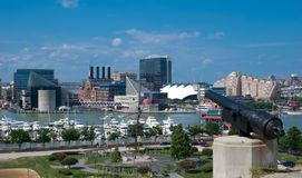 Baltimore Inner Harbor. Canon at Federal Hill overlooking Inner Harbor in Baltimore, Maryland Stock Photo
