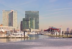 Baltimore Inner Harbor panorama in winter. BALTIMORE, USA - JANUARY, 31, 2014: Docked yachts, Rusty Scupper restaurant, Legg Mason Tower and Marriott hotel at stock photo