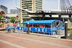 Baltimore inner harbor water taxi. Ship in Baltimore inner Harbor scenic area and downtown royalty free stock photo