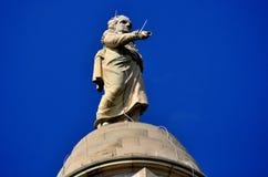 Baltimore, Maryland: George Washington Monument. Baltimore, Maryland - July 23, 2013:  Statue of President George Washington wearing a toga with lightning rods Stock Photos