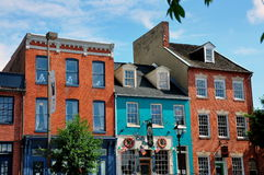 Baltimore, MD: Historic Houses at Fell's Point. Handsome 18th and 19th century brick houses lining the Thames Street waterfront now house trendy shops, pubs, and Royalty Free Stock Photo
