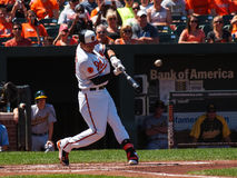 Baltimore Orioles Manny Machado. The Baltimore Orioles Manny Machado hits a single into left field during a Baltimore Orioles vs Oakland Athletics game on 8-25 Royalty Free Stock Images