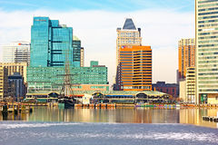 Baltimore, USA – January 31, 2014: View on downtown skyline from the Inner Harbor Pier 1. USS Constellation flagship, U.S. National Historic Landmark docked Royalty Free Stock Photos
