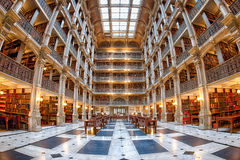 BALTIMORE, USA - JUNE 23, 2016 The interior of the Peabody Library. BALTIMORE, USA - JUNE 23, 2016 Bookshelf inside Peabody Library a research library for John Royalty Free Stock Images