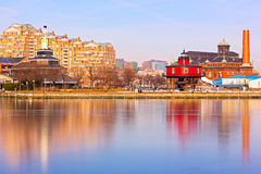 Baltimore waterfront buildings and the Seven Foot Knoll Lighthouse at sunset. Stock Photography