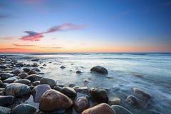 baltiskt över havssolnedgång Arkivbilder