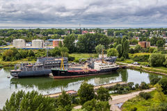 Baltiysk, Kaliningrad region, Russia - August 08, 2014: Aerial view to Russian military ships of Baltic fleet anchored in the bay Stock Photo