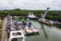 Baltiysk, Kaliningrad region, Russia - August 08, 2014: Aerial view to Russian military ships of Baltic fleet anchored in the bay Stock Photos