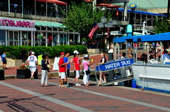 Baltmore, MD: People Boarding Water Taxi Stock Image