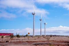 BALTRA, ECUADOR - NOVEMBER 11, 2018: Wind turbines supply energy to Baltra airport, the main one of the Galapagos. Islands and the one considered more royalty free stock photos