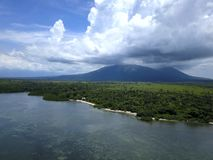 Aerial view of Baluran Mountain from the beach royalty free stock images