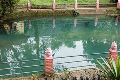 Baluster & green tranquil pond in park. In summer stock photos